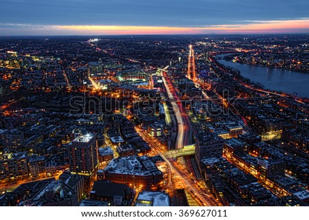 An aerial night view of Boston and the expressways, Massachusetts - stock photo