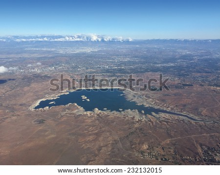 An aerial shot from 10,000 feet of Lake Mathews in Southern California shows how low the water level is during a bad drought.  - stock photo