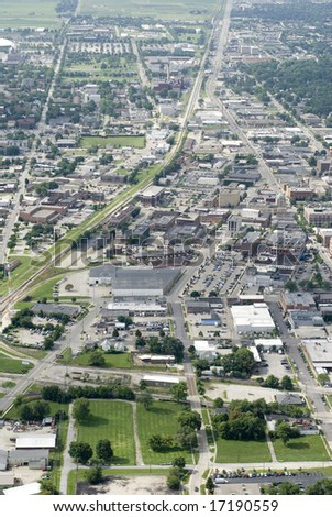 An aerial shot of a bustling small town. - stock photo