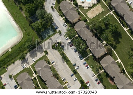 An aerial shot of a university parking lot. - stock photo