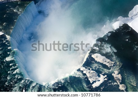 An aerial shot of the Canadian section of Niagara Falls, also known as Horseshoe Falls, with snow still present in early spring.