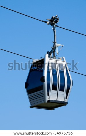 an aerial tramway cabin over the sky - stock photo