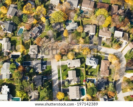 An aerial view of a residential area with several swimming pools. - stock photo