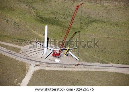 An aerial view of a wind farm under construction - stock photo