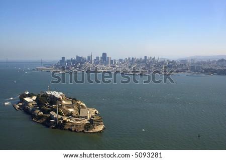 An aerial view of Alcatraz, Bay Bridge and San Francisco skyline. - stock photo