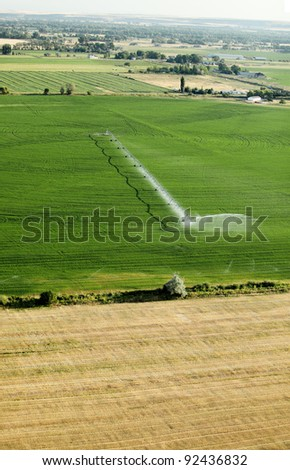An aerial view of an agricultural center pivot irrigation system - stock photo