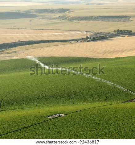 An aerial view of an agricultural center pivot sprinkler - stock photo