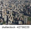 An aerial view of Beirut, the capital city of Lebanon, looking down on the area of Ras Beirut with the Hamra st. snaking into the distance and the lighthouse (manara) in between the buildings! - stock photo