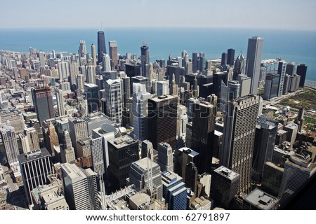 An aerial view of downtown Chicago looking over Lake Michigan