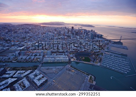 an aerial view of downtown san francisco with pier during sunset