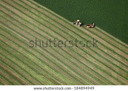 An aerial view of hay harvest - stock photo