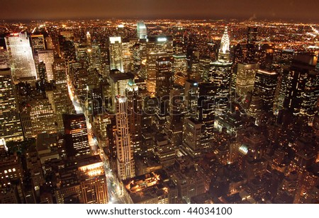 an aerial view of manhattan at night