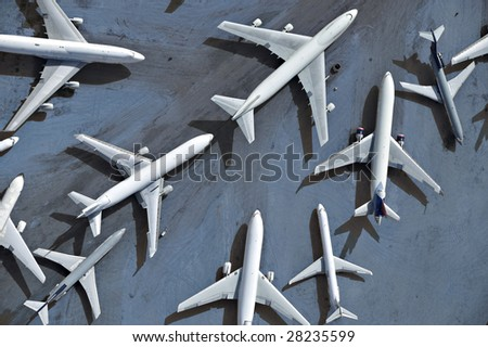 An aerial view of multiple airplanes on a runway - stock photo