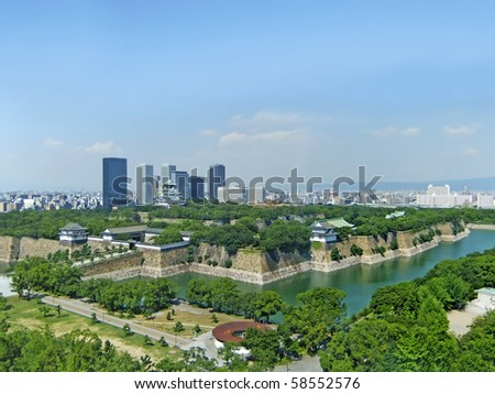 An aerial view of Osaka castle, castle park and surrounding Osaka - stock photo
