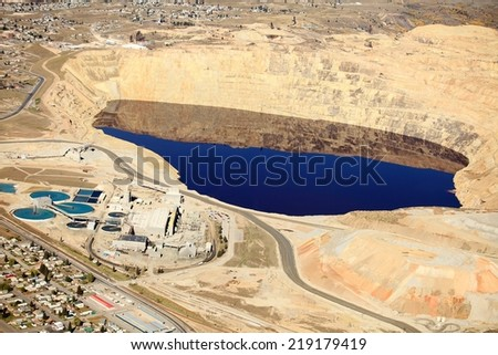 An aerial view of the evaporation pond and water treatment facilities at an open pit copper mine - stock photo