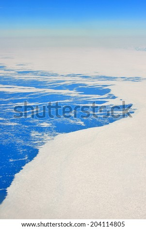 An aerial view of the frozen landscape of Greenland - stock photo
