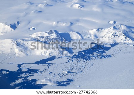 An aerial view of the frozen landscape of Greenland. - stock photo