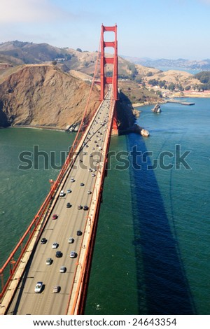 An aerial view of the Golden Gate Bridge on a sunny spring morning with Marin Headlands and Fort Baker in the background. - stock photo