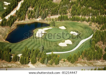 An aerial view of the green and fairway at a mountain resort golf course - stock photo