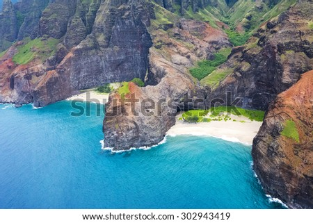 An aerial view of the Na Pali coast's jutting cliffs at Honopu Valley during a helicopter tour of the coast.  - stock photo