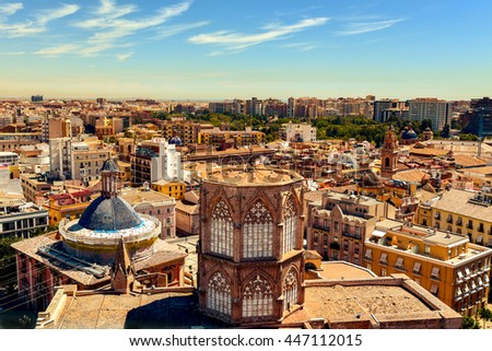 an aerial view of the roof of the Cathedral and the old town of Valencia, Spain, as seen from the Micalet, the belfry, highlighting the blue tiled dome of the Basilica de la Virgen de los Desamparados - stock photo