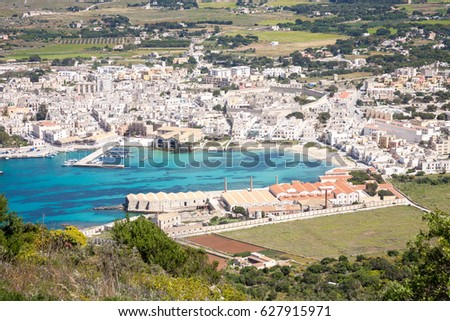 An aerial view on the town of Favignana on the island with the same name with the famous Tonnara in the foreground, Sicily, Italy