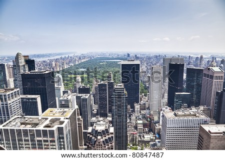 An aerial view over New York city, with the Empire State building in front. Amazing overlook at this big city. - stock photo