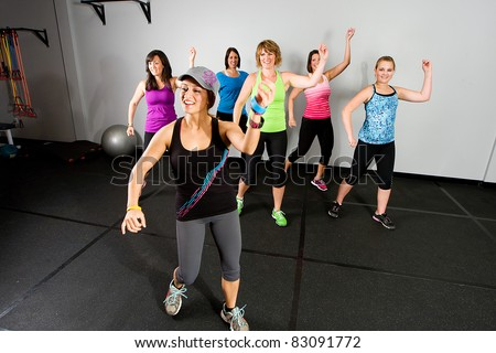 An aerobics and dance class for women at a gym. - stock photo