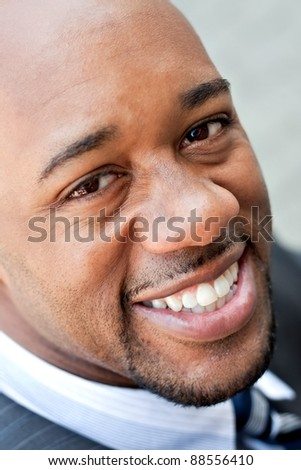 An African American business man wearing his sunglasses. - stock photo