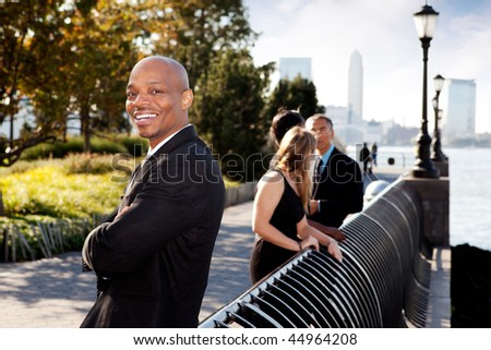 An African American business man with a big smile - stock photo