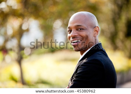 An African American business man with a big smile