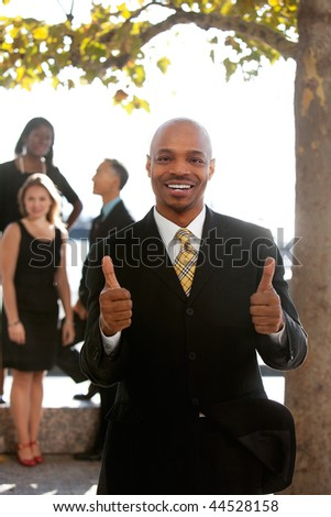 An african american business man with thumbs up - stock photo