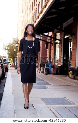 An African American business woman in an urban setting. - stock photo