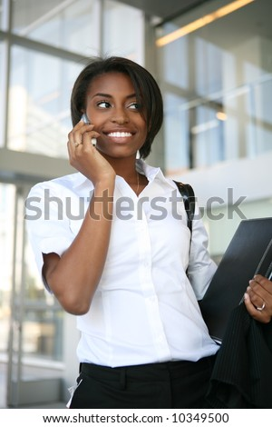 An african american business woman on the cell phone - stock photo