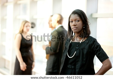 An african american business woman with colleagues in the background