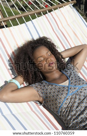 An African American female relaxing on hammock - stock photo