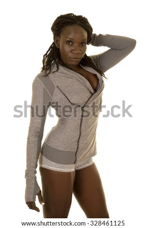 An African American in her fitness top and shorts. - stock photo