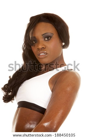 An African American in her white sports bra sweating after a workout. - stock photo