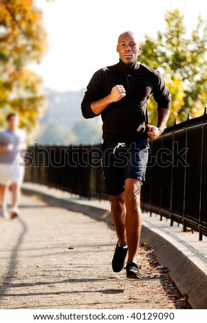 An African American jogging in a park in the morning