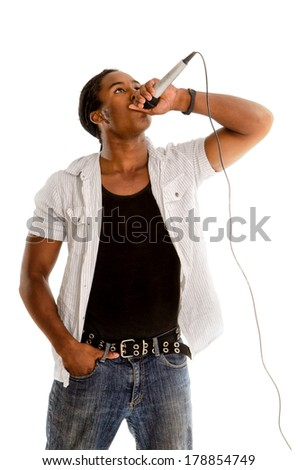 An African American Male Singer Performing with Microphone - stock photo