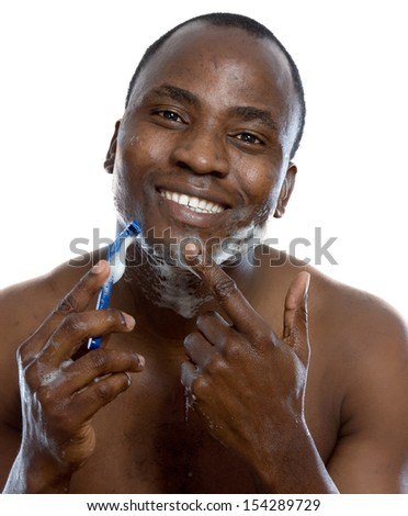 An african-american man shaving, isolated on white background - stock photo