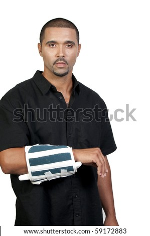An African American man with a broken arm - stock photo