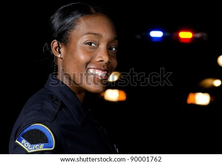 an African-American police officer working the night shift. - stock photo