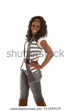 An African American standing in her cute clothes with a huge smile on her face.