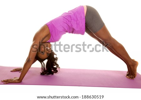 An African American stretching out her back and legs.
