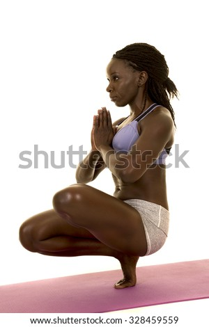 An African American woman balancing on her foot - stock photo