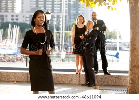 An African American woman in front of a business team