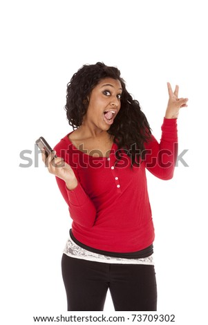 An African American woman is holding a phone. - stock photo