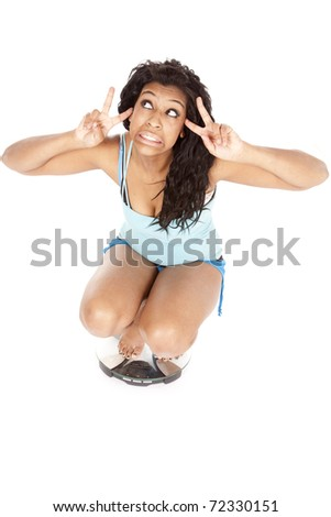 An African American woman is on the scales. - stock photo