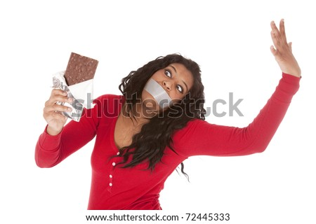An African American woman wants to eat some chocolate. - stock photo